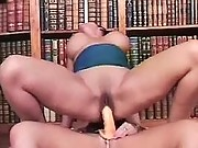 Horny lesbians have fun in library